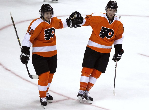Flyers' Briere congratulates Giroux for his goal against the Canadiens during the second period of their NHL hockey game in Philadelphia